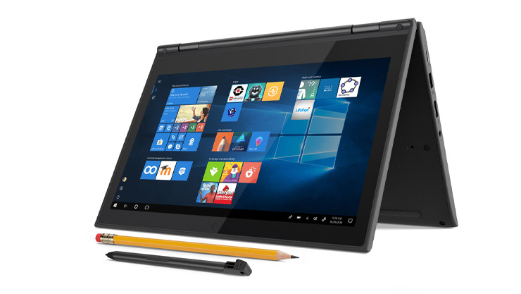 A laptop device with a pencil